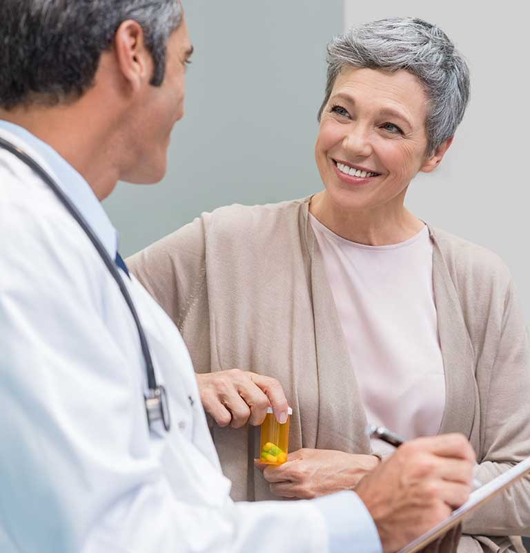 Physician talking to patient about hearing aids new york