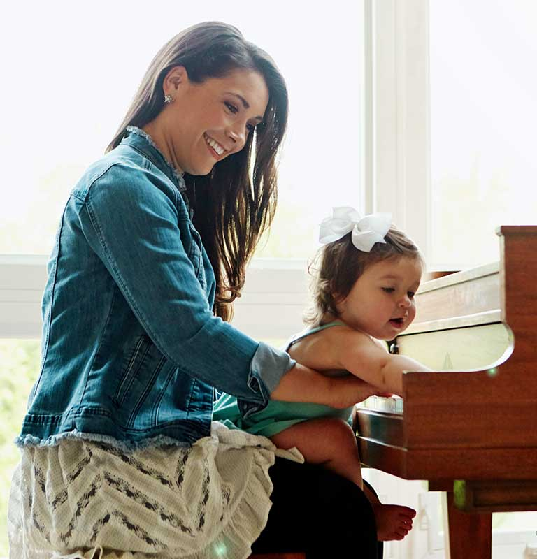 Mother and daughter taking piano lessons in Groton, NY