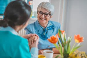 Woman with Alzheimer's smiling in Groton, NY